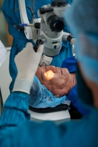 Doctor performing laser eye vision correction operation