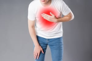 man having a chest pain