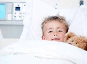 Sick Adorable Little Boy Lying In A Hospital Bed